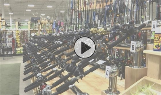 Shopping aisle filled with fishing rods
