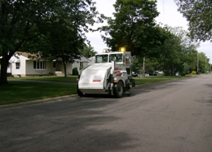 Street sweeper cleaning street
